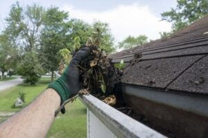 cleaning gutters and downspouts